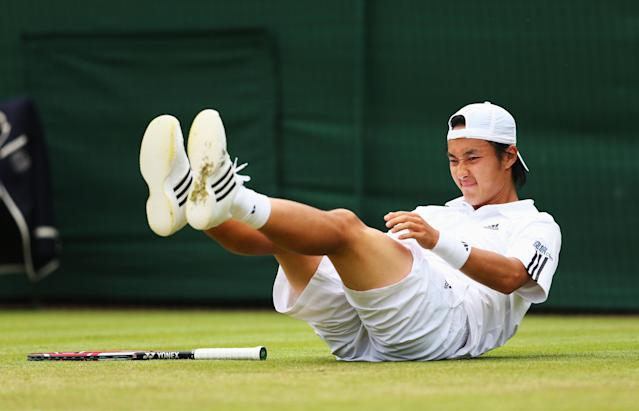 LONDON, ENGLAND - JUNE 27: Go Soeda of Japan slips on the grass during his Gentlemen's Singles second round match against Richard Gasquet of France on day four of the Wimbledon Lawn Tennis Championships at the All England Lawn Tennis and Croquet Club on June 27, 2013 in London, England. (Photo by Julian Finney/Getty Images)