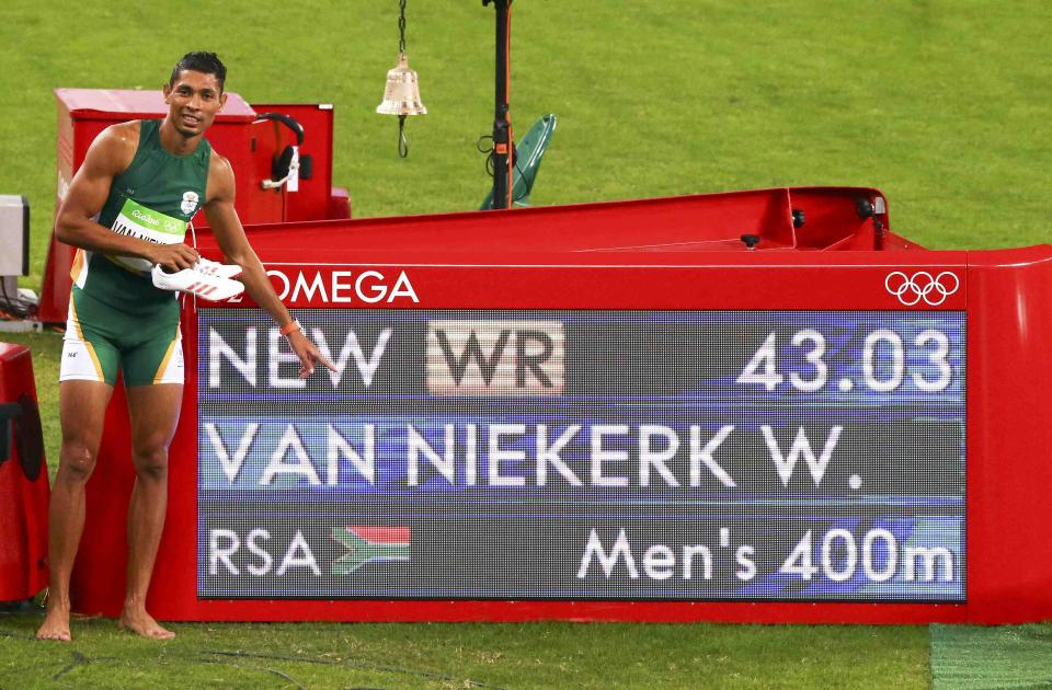 Wayde van Niekerk South Africa poses next to information board showing his world record in the 400M. (REUTERS)