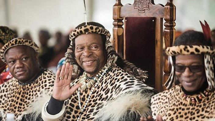 King Zwelithini waves at a ceremony dressed in customary clothing