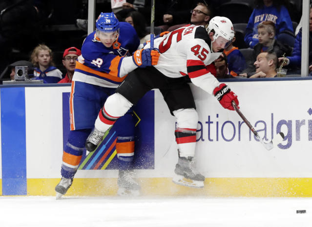 New York Islanders' Michael Dal Colle (28) evades New Jersey Devils' Sami Vatanen (45) during the second period of an NHL hockey game, Thursday, Jan. 17, 2019, in Uniondale, N.Y. (AP Photo/Frank Franklin II)