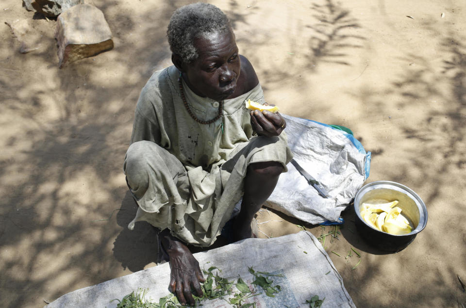 In this photo taken Sunday, March 19, 2017, Rosa Lyo eats fruit at a camp for those who were previously displaced by fighting, near a church in Rajaf, South Sudan. As the world marks World Water Day on Wednesday, March 22, 2017 more than 5 million people in South Sudan do not have access to safe, clean water, compounding the problems of famine and civil war, according to UNICEF. (Matthieu Alexandre/Caritas Internationalis via AP)