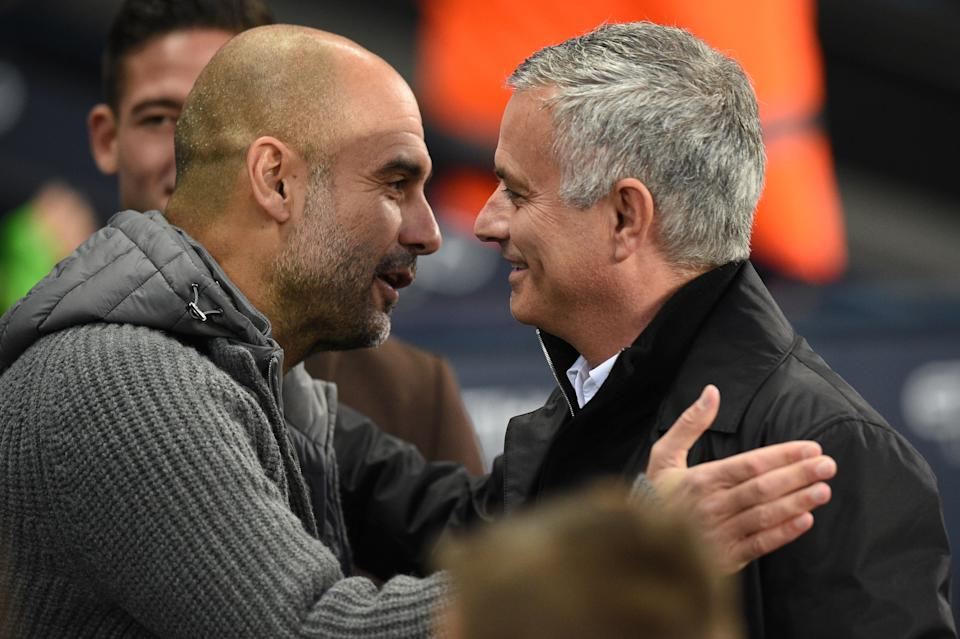 Manchester City's Spanish manager Pep Guardiola (L) greets Manchester United's Portuguese manager Jose Mourinho before the English Premier League football match between Manchester City and Manchester United at the Etihad Stadium in Manchester, north west England, on November 11, 2018. (Photo by Oli SCARFF / AFP) / RESTRICTED TO EDITORIAL USE. No use with unauthorized audio, video, data, fixture lists, club/league logos or 'live' services. Online in-match use limited to 120 images. An additional 40 images may be used in extra time. No video emulation. Social media in-match use limited to 120 images. An additional 40 images may be used in extra time. No use in betting publications, games or single club/league/player publications. /         (Photo credit should read OLI SCARFF/AFP via Getty Images)