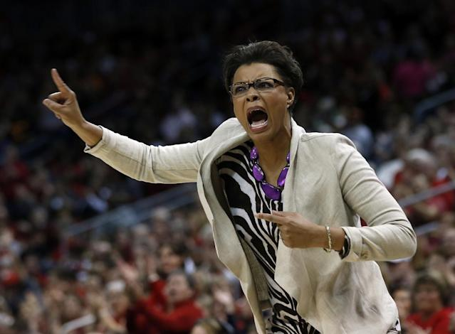 LSU head coach Nikki Caldwell directs her players from the bench during the first half of a regional semifinal game against Louisville at the NCAA college basketball tournament on Sunday, March 30, 2014, in Louisville, Ky. (AP Photo/John Bazemore)