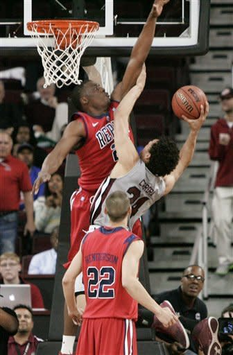 Mississippi's Reginald Buckner (23) tres to block the shoot as South Carolina's Michael Carrera (24) drives for the basket during the first half of an NCAA college basketball game Wednesday, Feb. 20, 2013, in Columbia, S.C. (AP Photo/Mary Ann Chastain)