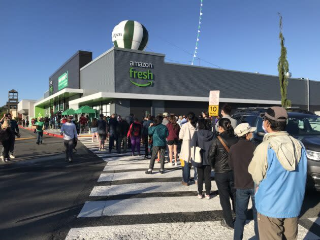 Customers line up to get into a new Amazon Fresh store in Bellevue, Wash. (GeekWire Photo / Alan Boyle)