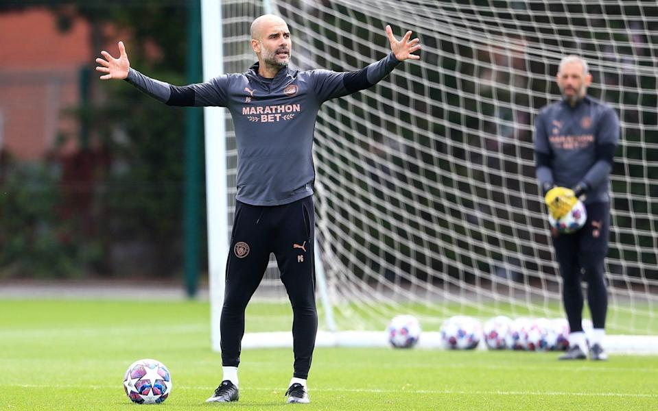 Pep Guardiola, manager of Manchester City in action during a training session at Manchester City - Getty Images
