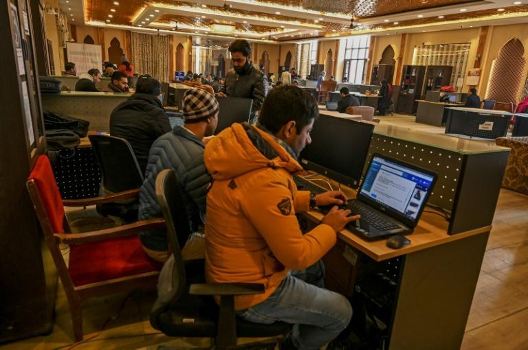 Students use the internet at a tourist reception centre. The Indian government cut Kashmir's access to the internet when it scrapped the region's autonomy in August