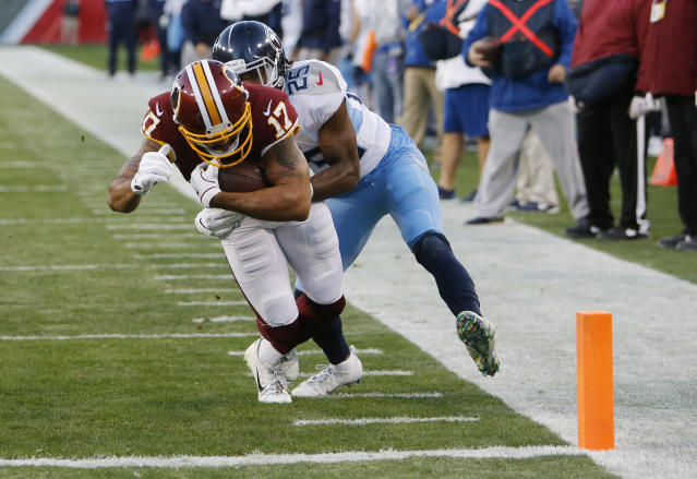 Washington Redskins wide receiver Michael Floyd (17) scores a touchdown on a 7-yard reception as he is defended by Tennessee Titans cornerback Adoree' Jackson (25) in the first half of an NFL football game Saturday, Dec. 22, 2018, in Nashville, Tenn. (AP Photo/James Kenney)