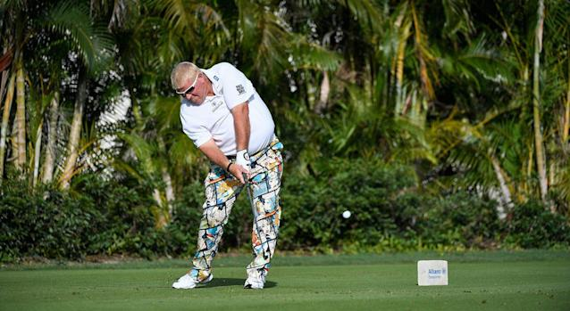 It was another day at the office for John Daly on Monday: beer, smokes, and golf with no shoes. (Ryan Young/PGA TOUR)