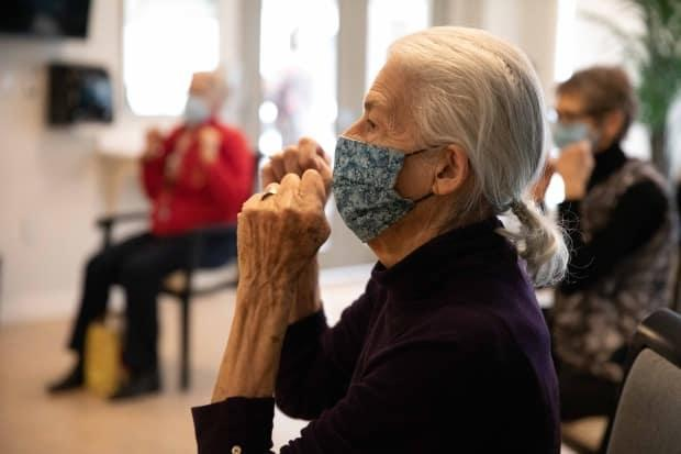 Jan Fleming takes a boxing class at Harbour Landing Village. She is one of 40 seniors who live in assisted living apartments inside the privately-run home for seniors.