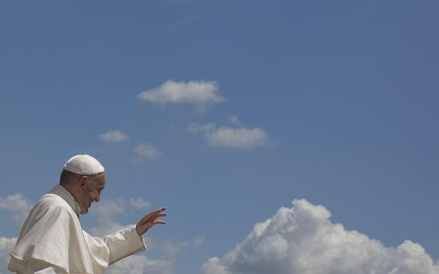 <p>Pope Francis waves to the faithful as he leaves St. Peter's Square at the Vatican after his weekly general audience , May 10, 2017. (Photo: Alessandra Tarantino/AP) </p>