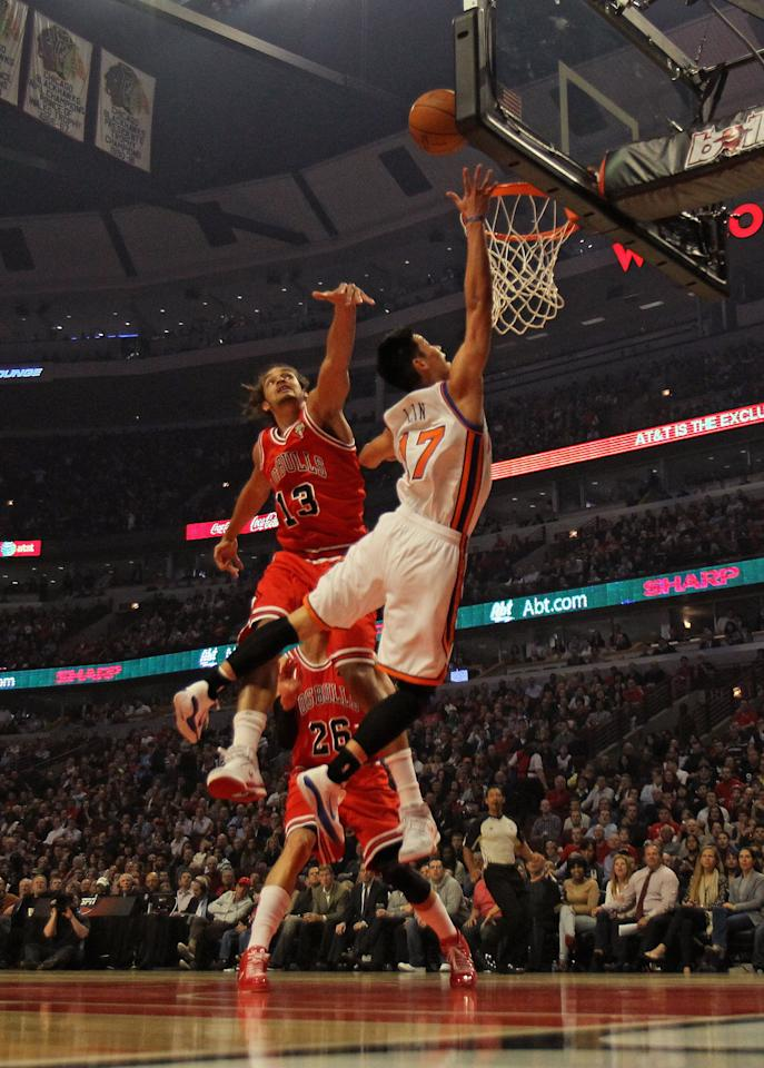 CHICAGO, IL - MARCH 12:  Jeremy Lin #17 of the New York Knicks goes up for a shot against Joakim Noah #13 of the Chicago Bulls at the United Center on March 12, 2012 in Chicago, Illinois. NOTE TO USER: User expressly acknowledges and agrees that, by downloading and or using this photograph, User is consenting to the terms and conditions of the Getty Images License Agreement.  (Photo by Jonathan Daniel/Getty Images)