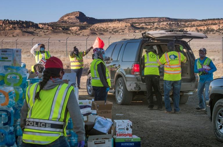Native Americans of the Navajo Nation people, pick up supplies from a food bank set up at the Navajo Nation town of Casamero Lake in New Mexico The Navajo Nation now has the highest per capita COVID-19 infection rate in the country after surpassing New York. (AFP Photo/Mark RALSTON)