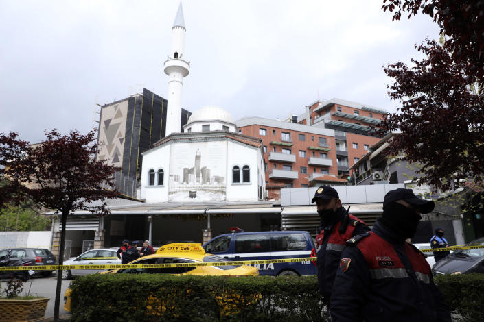 Albanian police stand outside Dine Hoxha mosque, after a knife attack in Tirana, Albania, Monday, April 19, 2021. Police say an Albanian man with a knife has attacked five people at a mosque in the capital of Tirana. A police statement said Rudolf Nikolli, 34, entered the Dine Hoxha mosque in downtown Tirana about 2:30 p.m. and wounded five people with a knife. (AP Photo)