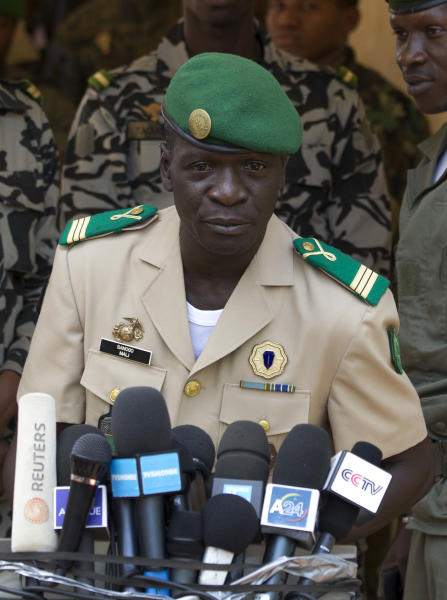 Coup leader Capt. Amadou Haya Sanogo addresses the press, at junta headquarters in Kati, outside Bamako, Mali Sunday, April 1, 2012. The leader of Mali's recent coup says he is reinstating the nation's previous constitution amid international pressure to restore constitutional order. Sanogo said a national convention would be held to organize elections, but he failed to announce a timeline for the elections.(AP Photo/Rebecca Blackwell)