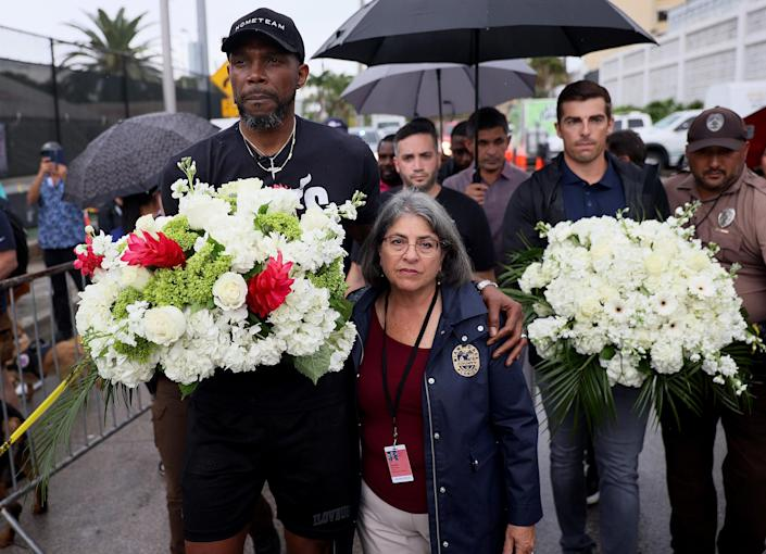 Image: Udonis Haslem of the Miami Heat and Miami-Dade County Mayor Daniella Levine Cava arrive at a memorial after the Champlain Towers South building collapse on June 30, 2021 in Surfside, Fla. (Joe Raedle / Getty Images file)
