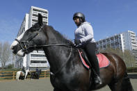 Zion Mcleod, 13, rides Eddie during a riding lesson at Ebony Horse Club in Brixton, south London, Sunday, April 18, 2021. In the midst of south London's hustle and bustle, only a 10-minute walk from a subway station, is a school where children are encouraged to horse around. The Ebony Horse Club provides 140 rides per week to children in the local community offering them the opportunity to learn important life skills along with horseback riding. (AP Photo/Kirsty Wigglesworth)