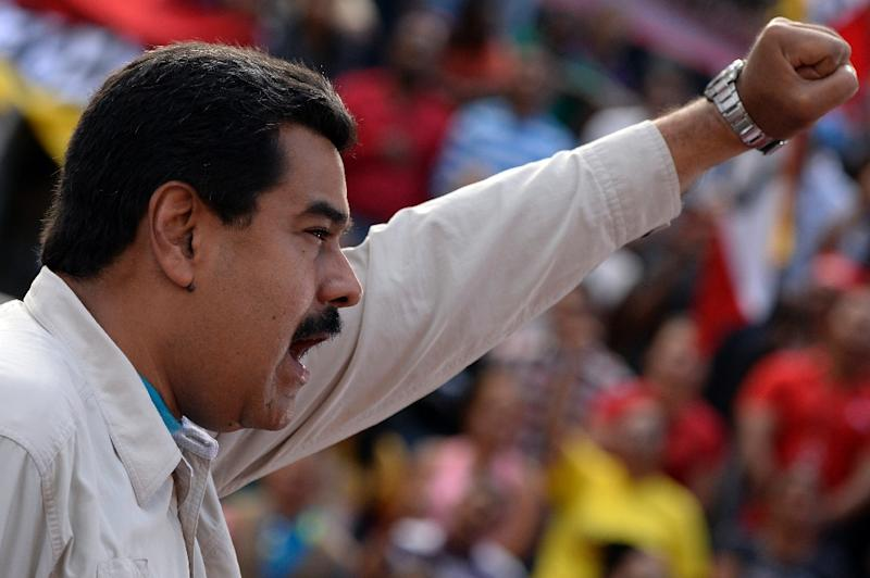 Venezuelan President Nicolas Maduro delivers a speech before supporters outside the presidential palace in Caracas on March 12, 2015