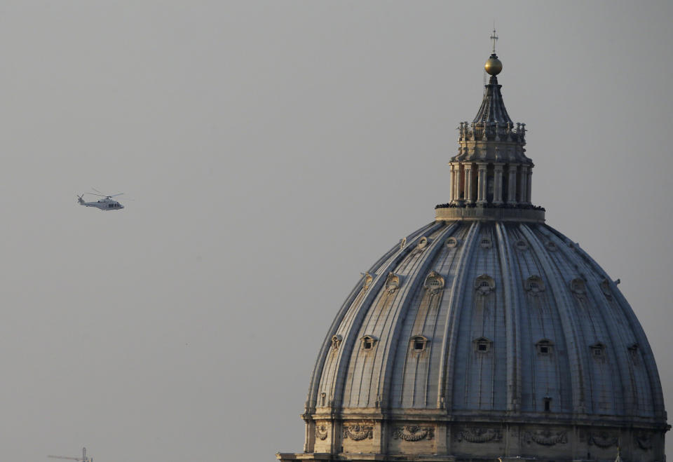 The helicopter taking Pope Benedict XVI to Castel Gandolfo leaves the Vatican in Rome, Thursday, Feb. 28, 2013. Shortly before 5 p.m. on Thursday, Pope Benedict left the Apostolic palace inside the Vatican for the last time as pontiff, headed to the helipad at the top of the hill in the Vatican gardens and flew to the papal retreat at Castel Gandolfo south of Rome. There, at 8 p.m. sharp, Benedict will become the first pontiff in 600 years to resign. (AP Photo/Gregorio Borgia)