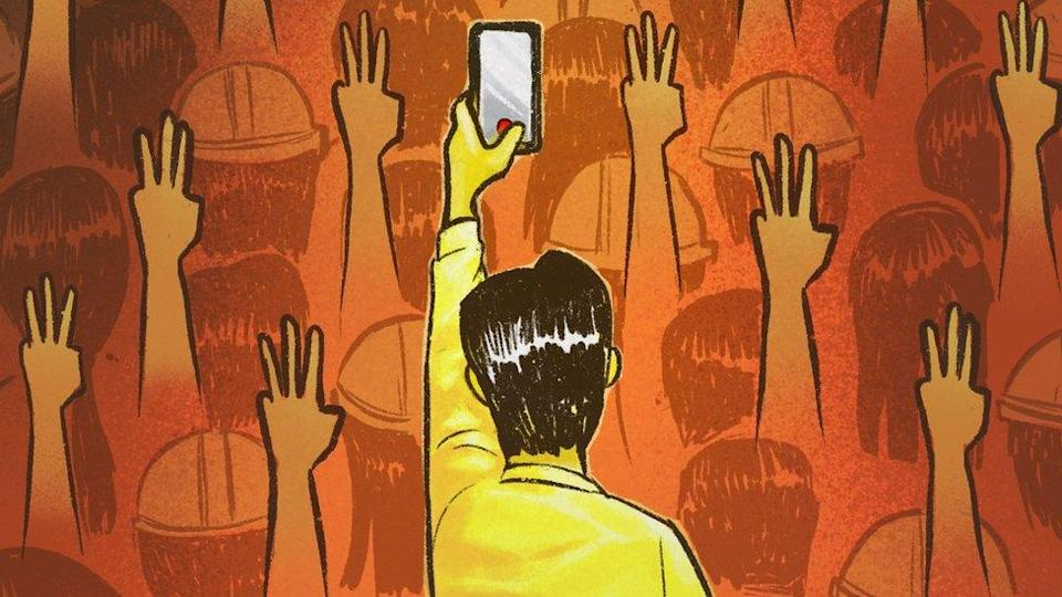 A man holding up his phone