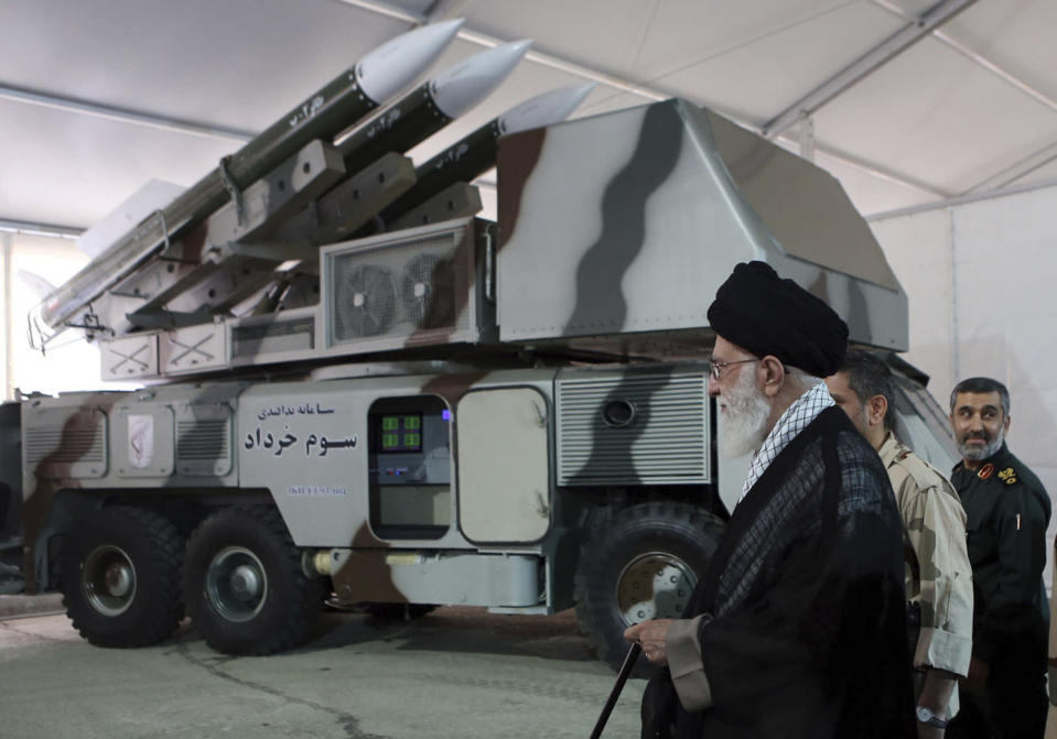 In this photo released on May 11, 2014, by an official website of the office of the Iranian supreme leader, Third of Khordad air defense system is displayed while Supreme Leader Ayatollah Ali Khamenei visits an exhibition of achievements of Revolutionary Guard's aerospace division, in Iran. Iran's Revolutionary Guard shot down a U.S. surveillance drone Thursday, June 20, 2019, in the Strait of Hormuz, marking the first time the Islamic Republic directly attacked the American military amid tensions over Tehran's unraveling nuclear deal with world powers. Iran said it has used its air defense system known as Third of Khordad to shoot down the drone — a truck-based missile system that can fire up to 18 miles (30 kilometers) into the sky. (Office of the Iranian Supreme Leader via AP)