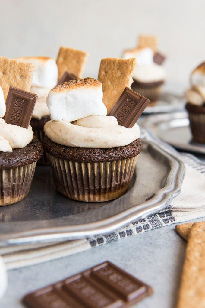 """<p>Summertime and s'mores go hand-in-hand, so skip the campfire this 4th of July and bring these s'mores-inspired cupcakes instead.</p><p><strong>Get the recipe at <a href=""""https://houseofnasheats.com/smores-cupcakes-with-graham-cracker-frosting/"""" rel=""""nofollow noopener"""" target=""""_blank"""" data-ylk=""""slk:House of Nash Eats"""" class=""""link rapid-noclick-resp"""">House of Nash Eats</a>.</strong><br><br><a class=""""link rapid-noclick-resp"""" href=""""https://go.redirectingat.com?id=74968X1596630&url=https%3A%2F%2Fwww.walmart.com%2Fsearch%2F%3Fquery%3DPLATTERS&sref=https%3A%2F%2Fwww.thepioneerwoman.com%2Ffood-cooking%2Frecipes%2Fg36343624%2F4th-of-july-cupcakes%2F"""" rel=""""nofollow noopener"""" target=""""_blank"""" data-ylk=""""slk:SHOP PLATTERS"""">SHOP PLATTERS</a></p>"""