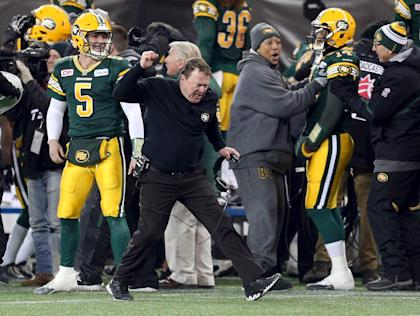 Edmonton Eskimos head coach Chris Jones celebrates on the sidelines during his team's victory over the Ottawa Redblacks in the CFL's 103rd Grey Cup championship football game in Winnipeg, Manitoba, November 29, 2015. REUTERS/Kelly Morton EDITORIAL USE ONLY. NO RESALES. NO ARCHIVE