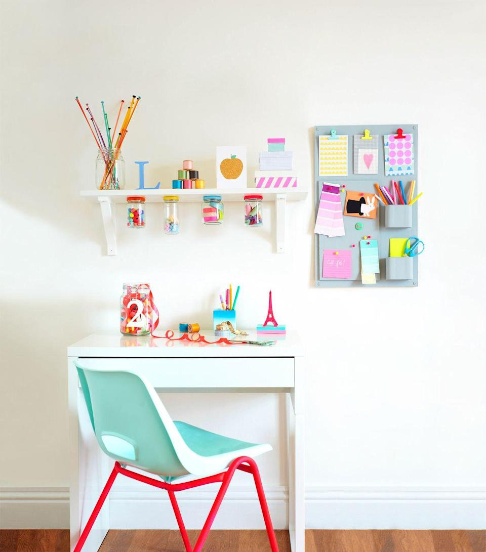 <p>If your home office features white walls, introduce color in the form of a desk chair and accessories, like pencil cups, pinboards, and small storage boxes.</p>