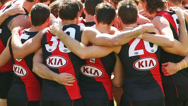 Essendon players, pictured here during the round 22 match against Gold Coast in 2014.