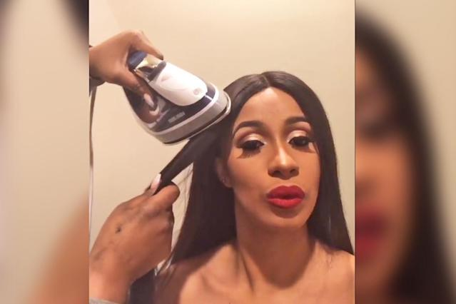 Cardi B's stylist uses a clothing iron to straighten her hair. (Photo: Instagram/Cardi B)
