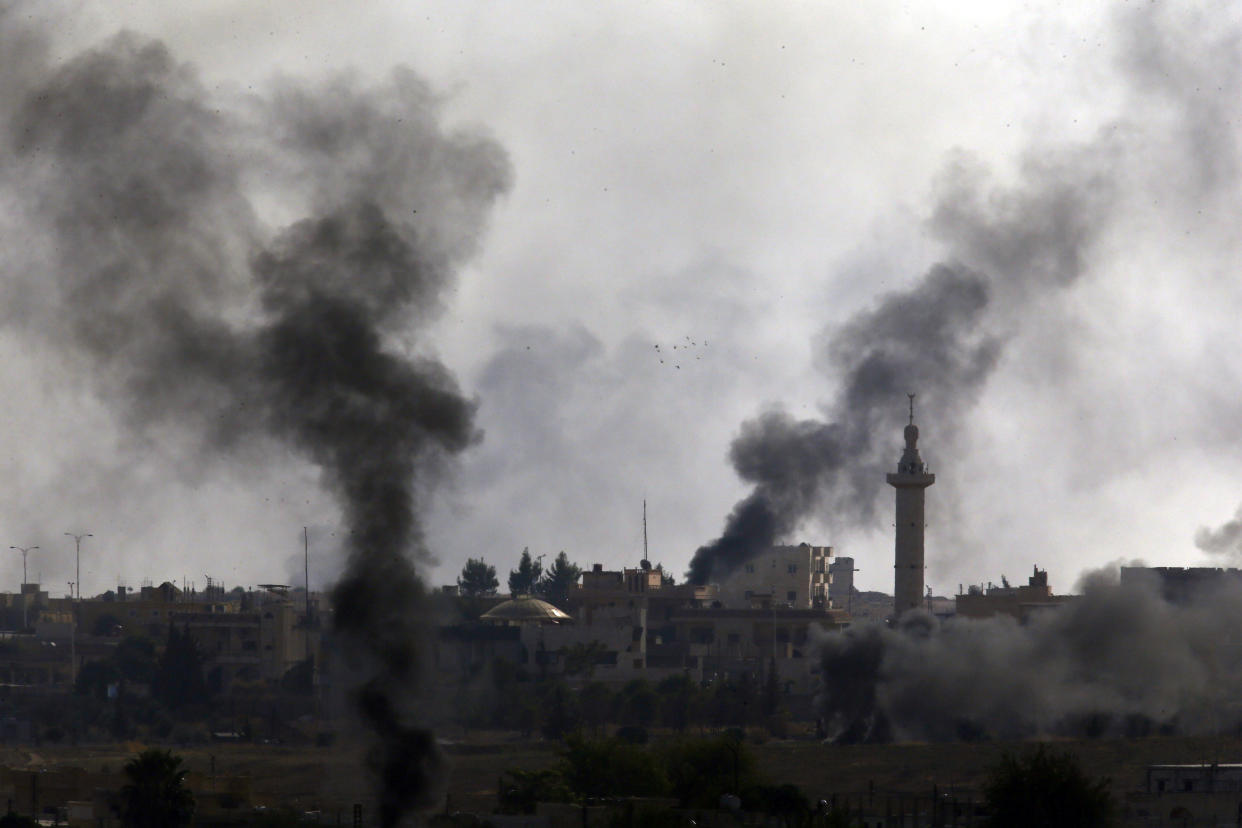 Smoke billows from targets inside Syria during bombardment by Turkish forces. (Photo: Lefteris Pitarakis/AP)