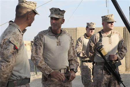U.S. Marine Corps Major General Gregg A. Sturdevant (2nd L) speaks to Marines at Camp Hanson in Helmand province, Afghanistan in this November 22, 2012 handout photograph provided by the U.S. REUTERS/Sgt. Keonaona C. Paulo/U.S. Marine Corps/Handout via Reuters