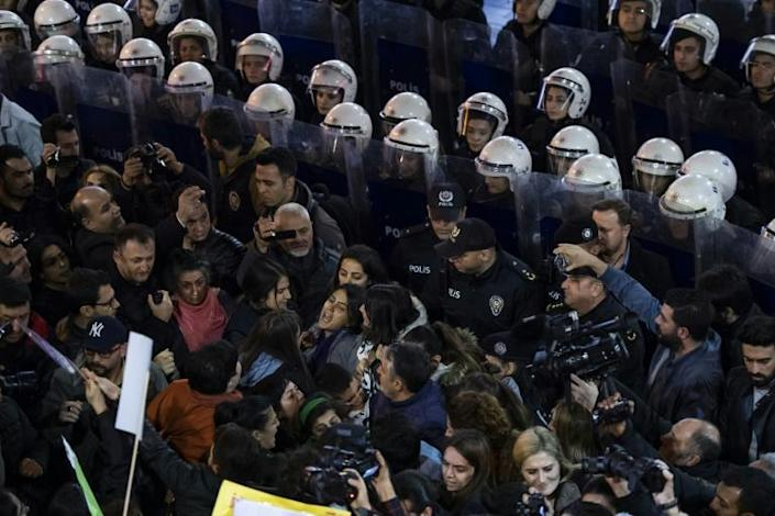 Riot police in Istanbul blocked the path of roughly 2,000 protesters before firing tear gas and plastic bullets to disperse them (AFP Photo/Yasin AKGUL)