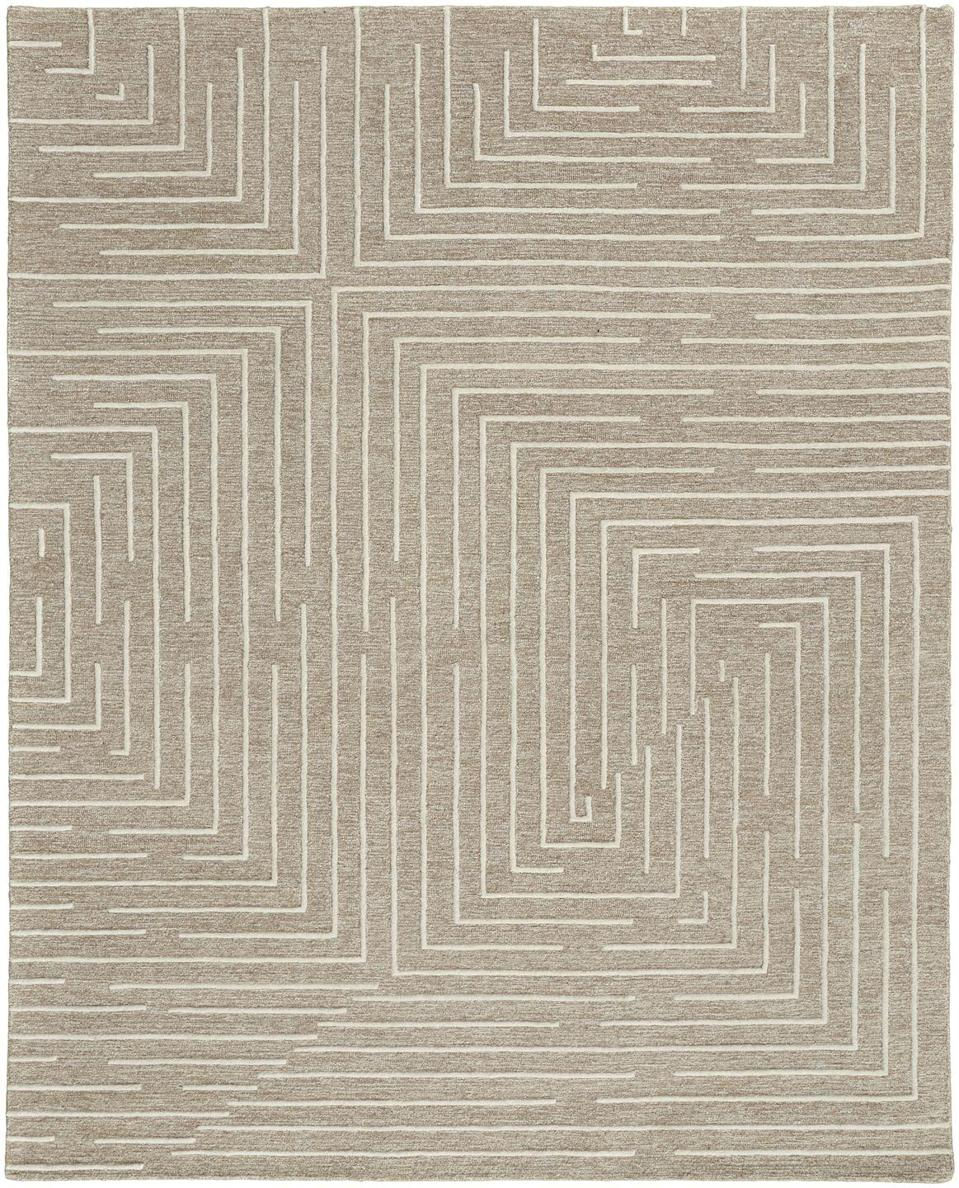 """<p>For his debut with the rug manufacturer <a href=""""https://www.feizy.com/"""" rel=""""nofollow noopener"""" target=""""_blank"""" data-ylk=""""slk:Feizy"""" class=""""link rapid-noclick-resp"""">Feizy</a>, ELLE DECOR A-List designer <a href=""""https://www.elledecor.com/design-decorate/house-interiors/a31039049/thom-filicia-new-manhattan-apartment/"""" rel=""""nofollow noopener"""" target=""""_blank"""" data-ylk=""""slk:Thom Filicia"""" class=""""link rapid-noclick-resp"""">Thom Filicia</a> decided to stick with a neutral palette. From graphic labyrinthine motifs like Fenner (<em>shown here</em>) to animal prints, there's sure to be something for everyone. </p>"""