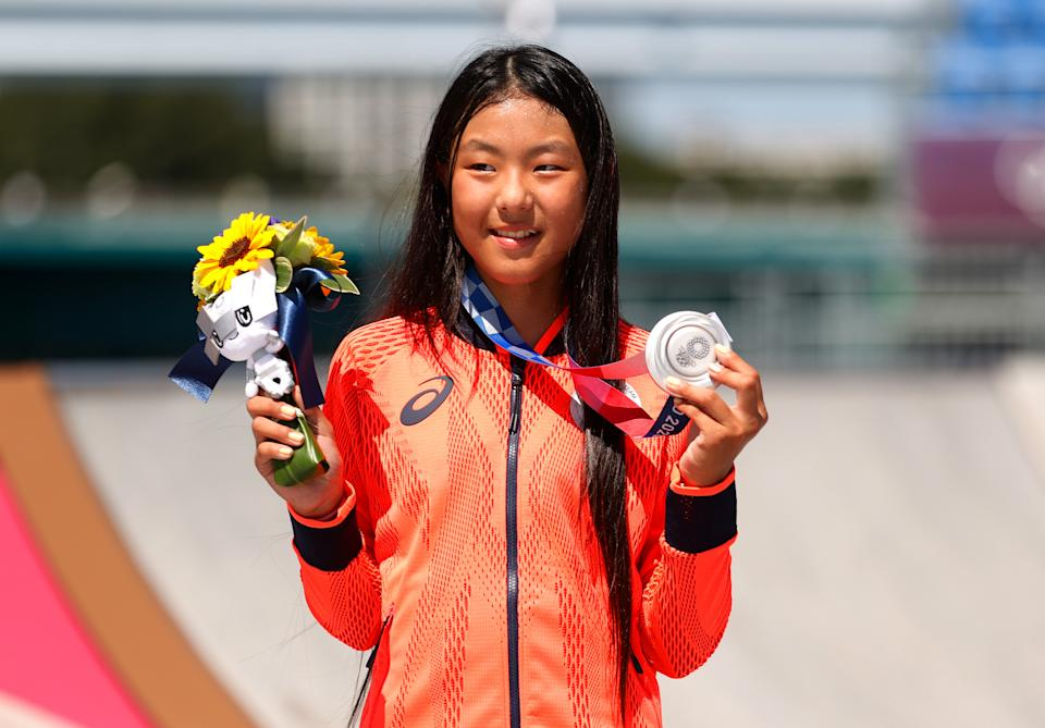 TOKYO, JAPAN - AUGUST 04: Kokona Hiraki of Team Japan poses with her Silver medal after the Women's Skateboarding Park Finals on day twelve of the Tokyo 2020 Olympic Games at Ariake Urban Sports Park on August 04, 2021 in Tokyo, Japan. (Photo by Ezra Shaw/Getty Images)