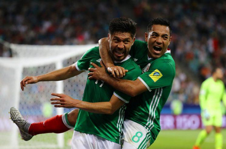 Oribe Peralta, left, celebrates scoring the game-winning goal against New Zealand with Marco Fabian. (Reuters)
