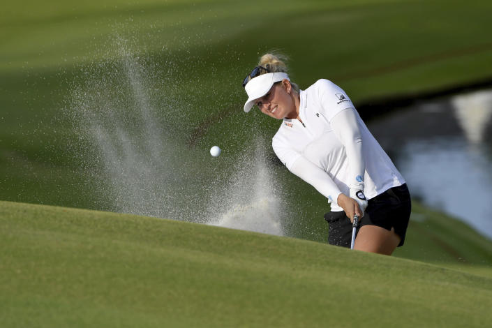 Nanna Koerstz Madsen of Denmark, chips onto the 18th green during the first round of the LPGA Walmart NW Arkansas Championship golf tournament, Friday, Sept. 24, 2021, in Rogers, Ark. (AP Photo/Michael Woods)