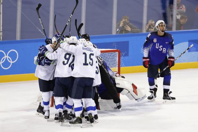United States forward Jordan Greenway, right, looks away after Slovenia scored its second goal on Wednesday in both teams' Olympic hockey opener in PyeongChang, South Korea. (Reuters)