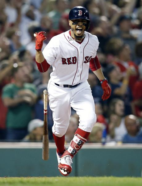 Boston Red Sox's Mookie Betts reacts to his grand slam during the fourth inning of a baseball game against the Toronto Blue Jays in Boston, Thursday, July 12, 2018. (AP Photo/Michael Dwyer)