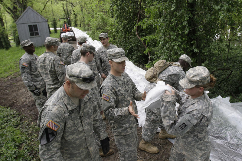 Members of the Indiana Army National Guard place sandbags along the Wabash River in New Harmony, Ind., Tuesday, April 26, 2011. (AP Photo/Darron Cummings)