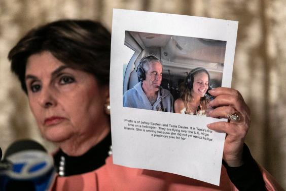 Gloria Allred shows a press conference a photo of Jeffrey Epstein and her client Teala Davies (AP)