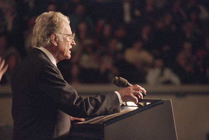 FILE - In this Sunday, April 23, 1995 file photo, the Rev. Billy Graham speaks to the capacity crowd at a prayer service at the State Fair Arena in Oklahoma City, for the victims of Wednesday's fatal car-bombing of the Alfred P. Murrah Federal Building in downtown Oklahoma City. (AP Photo/Wilfredo Lee)