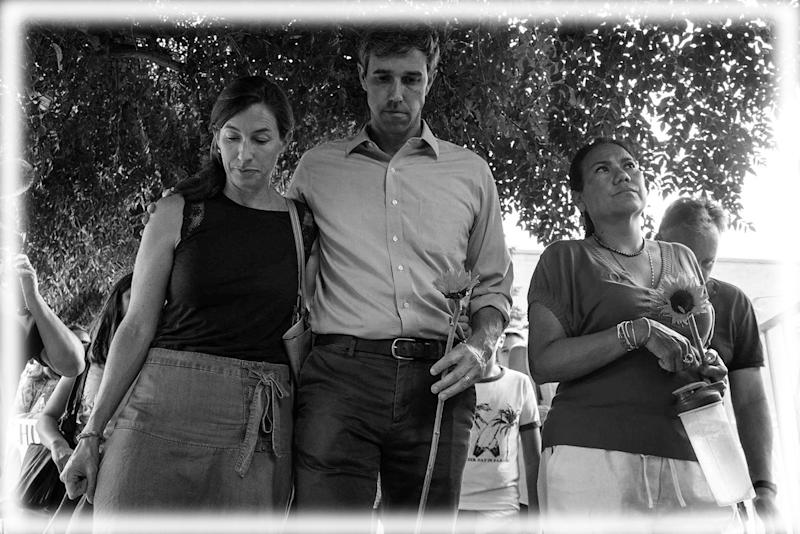 Beto O'Rourke walks next to his wife Amy Hoover Sanders and US Rep. Veronica Escobar during a silent march holding sunflowers in honor to the victims of a mass shooting occurred in Walmart on Satuday morning in El Paso on Sunday, August 4, 2019. (Photo: TNS via ZUMA Wire; digitally enhanced by Yahoo News)