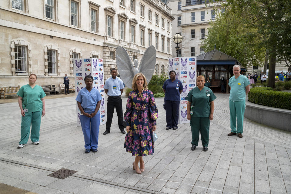 Kate Garraway with the NHS staff who will be featured at the end of the awards ceremony (Pride of Britain/PA)