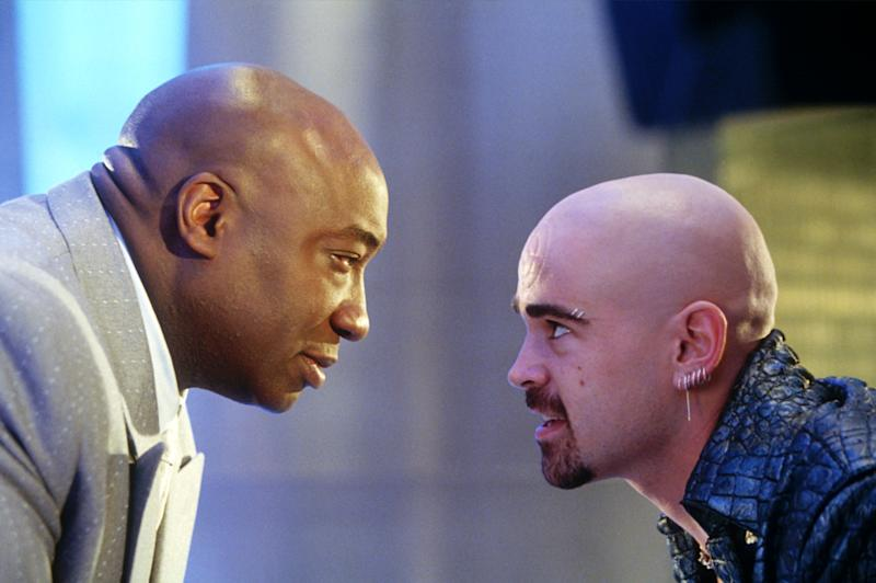 """In this undated movie still provided by Twentieth Century Fox, the crime lord Kingpin, played by Michael Clarke Duncan, left, hires Bullseye, played by Colin Farrell, in a scene from the movie """"Daredevil"""", based on a popular comic book published by Marvel. Duncan, the hulking, prolific character actor whose dozens of films included an Oscar-nominated performance as a death row inmate in """"The Green Mile"""" and such other box office hits as """"Armageddon,"""" ''Planet of the Apes"""" and """"Kung Fu Panda,"""" is dead at age 54. (AP Photo/20th Century Fox, Zade Rosenthal)"""