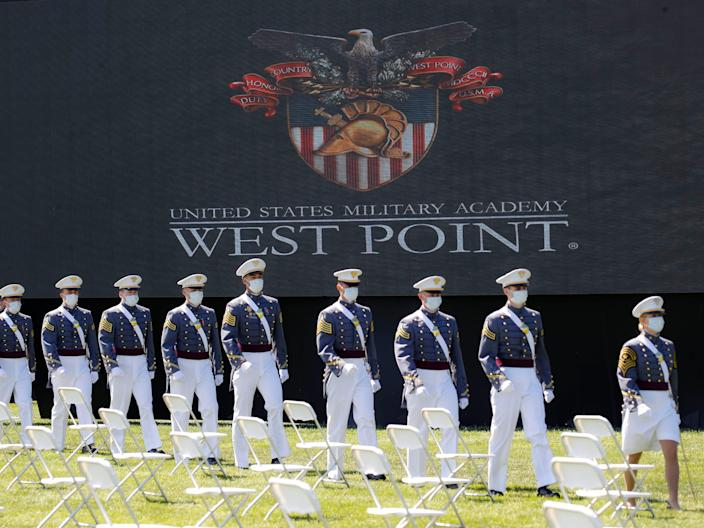 <p>Graduating cadets march to their socially-distanced seating during commencement ceremonies in West Point, New York last June</p> (AP)
