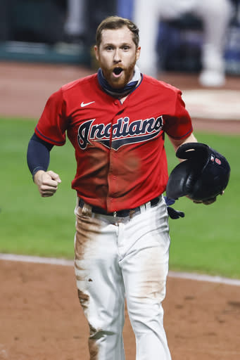 Cleveland Indians' Jordan Luplow celebrates after scoring on a single by Delino DeShields off Pittsburgh Pirates relief pitcher Chris Stratton during the ninth inning of a baseball game, Friday, Sept. 25, 2020, in Cleveland. (AP Photo/Ron Schwane)