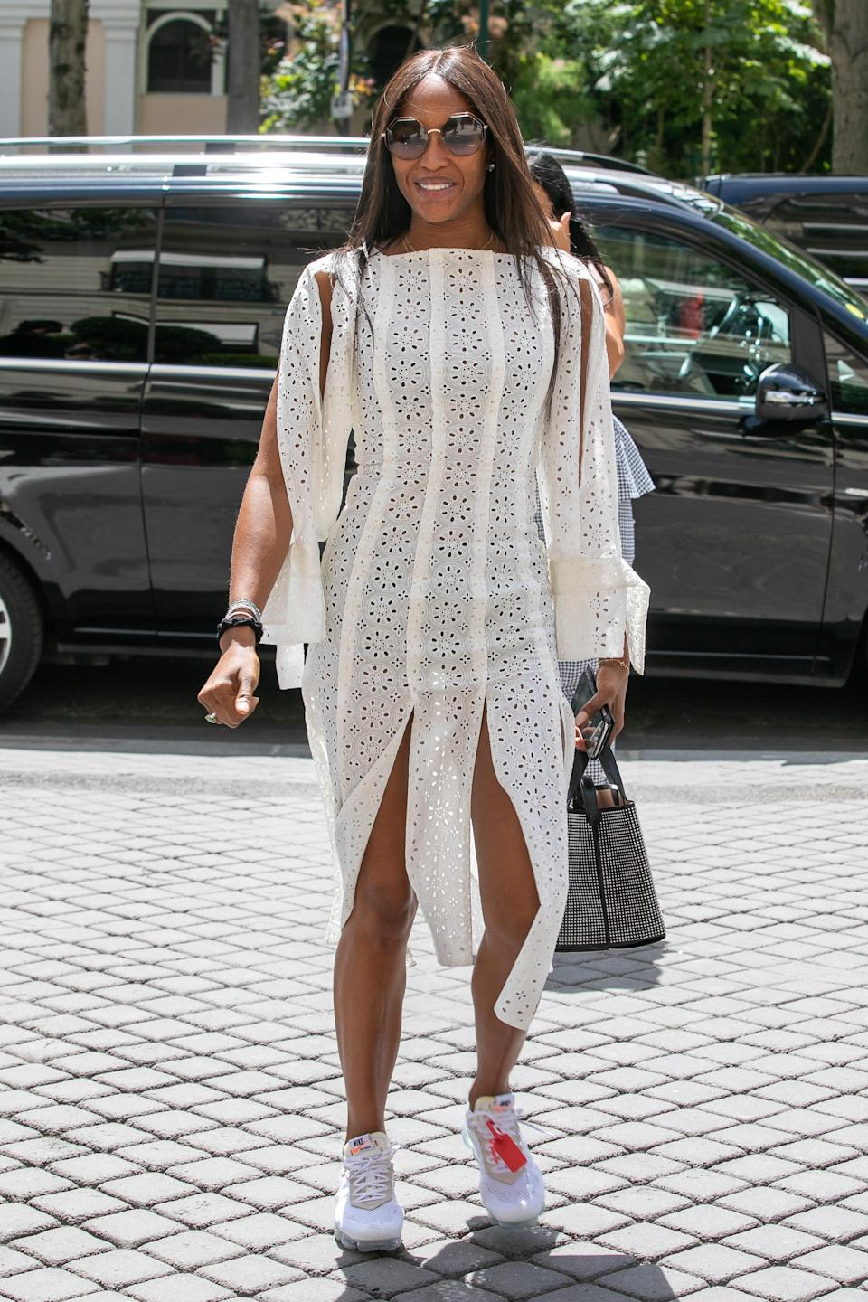 <p>Naomi Campbell looked happy and summery as she wondered around Paris in a white dress with slits at the skirt. <br><em>[Photo: Getty]</em> </p>