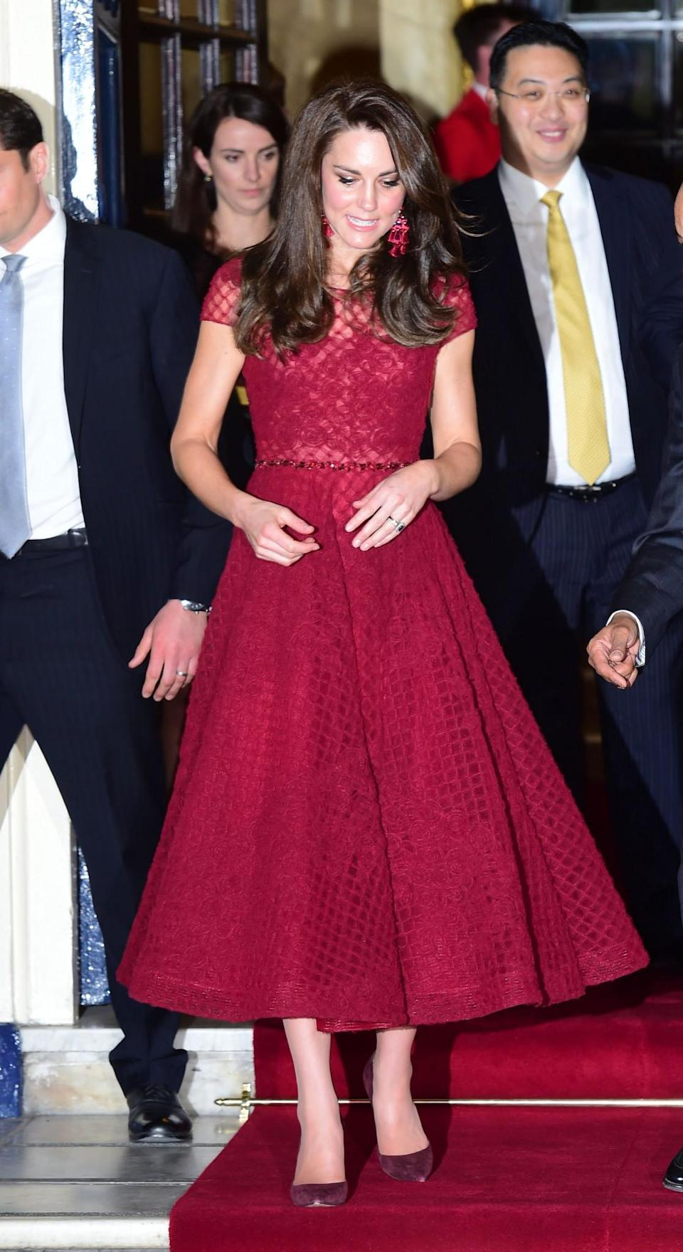 <p>Kate donned the colour of the season for the opening night of West End musical, <i>42nd Street</i>. Wearing a claret midi-length dress by Marchesa Notte (that cost £1,105), the Duchess opted for some seriously fashion-forward accessories including a pair of pom pom statement earrings from Kate Spade. Gianvito Rossi pumps and a matching Mulberry clutch topped off the look.<br><i>[Photo: PA]</i> </p>