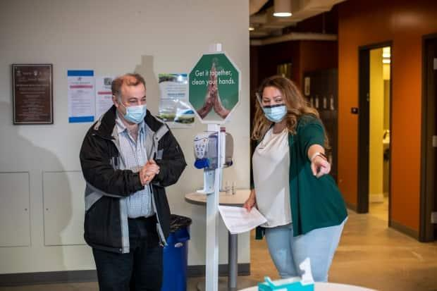 A registered nurse prepares to deliver a COVID-19 vaccination to a frontline worker at Vancouver General Hospital on March 4.  (Ben Nelms/CBC - image credit)